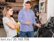 Купить «Couple is choosing new motobike and woman is surprised choice her husband», фото № 30160708, снято 8 мая 2018 г. (c) Яков Филимонов / Фотобанк Лори