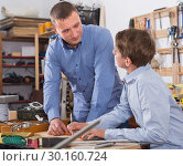 Купить «adult father teaching son сarpentry in the garage», фото № 30160724, снято 17 мая 2017 г. (c) Яков Филимонов / Фотобанк Лори