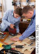 Купить «Woodworker working with pupil», фото № 30160736, снято 17 мая 2017 г. (c) Яков Филимонов / Фотобанк Лори