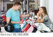 Купить «Couple selecting new motobike», фото № 30160896, снято 8 мая 2018 г. (c) Яков Филимонов / Фотобанк Лори