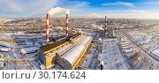 Купить «Power plant pipes on the background of the panorama of the winter city against blue sky», фото № 30174624, снято 8 декабря 2019 г. (c) Mikhail Starodubov / Фотобанк Лори