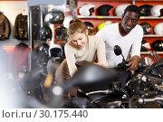Купить «couple in motorcycle shop choosing new vehicle», фото № 30175440, снято 16 января 2019 г. (c) Яков Филимонов / Фотобанк Лори