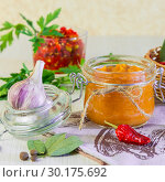 Food. Homemade harvest preservation. Dietary vegetable puree of zucchini, pumpkin, carrot, pepper with spices, garlic and jam in glass jars. Стоковое фото, фотограф Светлана Евграфова / Фотобанк Лори
