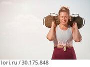 Купить «Athletic woman training with sand bag at the seaside», фото № 30175848, снято 9 сентября 2018 г. (c) Pavel Biryukov / Фотобанк Лори