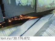 Купить «Work of an industrial surface grinding machine. Grinding of a flat metal part.», фото № 30176872, снято 27 сентября 2018 г. (c) Андрей Радченко / Фотобанк Лори