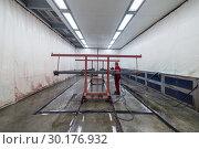 Купить «Metal frames in the spray booth. Industrial painting of metal products», фото № 30176932, снято 21 июня 2018 г. (c) Андрей Радченко / Фотобанк Лори