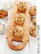 Купить «Diet oat muffins with raisins», фото № 30177660, снято 5 апреля 2018 г. (c) Надежда Мишкова / Фотобанк Лори