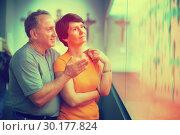 Купить «Romantic elderly couple interested in objects of applied arts in», фото № 30177824, снято 22 октября 2017 г. (c) Яков Филимонов / Фотобанк Лори