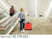 Купить «Girl coming down stairs in subway with suitcase», фото № 30178024, снято 27 апреля 2018 г. (c) Яков Филимонов / Фотобанк Лори