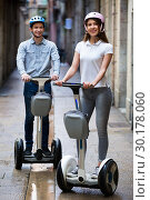 Купить «Positive boy and girl posing on segways in vacation», фото № 30178060, снято 15 сентября 2019 г. (c) Яков Филимонов / Фотобанк Лори