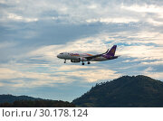 Купить «Airbus flying over the mountains», фото № 30178124, снято 26 ноября 2016 г. (c) Игорь Жоров / Фотобанк Лори