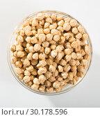 Купить «Bowl with raw dried chickpeas», фото № 30178596, снято 7 июля 2020 г. (c) Яков Филимонов / Фотобанк Лори