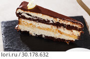 Купить «Delicious layer lemon сhocolate сake сloseup», фото № 30178632, снято 19 марта 2019 г. (c) Яков Филимонов / Фотобанк Лори