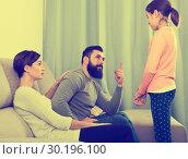 Купить «Father and mother telling off daughter», фото № 30196100, снято 27 марта 2019 г. (c) Яков Филимонов / Фотобанк Лори