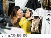Купить «Woman and girl choosing pretty skirt», фото № 30196156, снято 28 февраля 2020 г. (c) Яков Филимонов / Фотобанк Лори