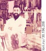 Купить «Seller working with meat in butcher's shop», фото № 30196208, снято 16 ноября 2016 г. (c) Яков Филимонов / Фотобанк Лори
