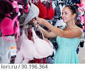 Купить «Woman buying bra», фото № 30196364, снято 19 июня 2017 г. (c) Яков Филимонов / Фотобанк Лори