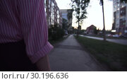 Купить «Rear View Of A Young Unidentified Woman In Formal Clothes Walking Along The Sidewalk», видеоролик № 30196636, снято 3 октября 2018 г. (c) Pavel Biryukov / Фотобанк Лори