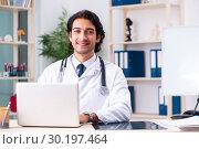 Купить «Young handsome doctor in telemedicine concept», фото № 30197464, снято 12 ноября 2018 г. (c) Elnur / Фотобанк Лори