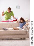 Купить «Husband helping leg injured wife in housework», фото № 30200444, снято 4 октября 2018 г. (c) Elnur / Фотобанк Лори