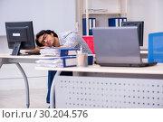 Купить «It specialist working in the office», фото № 30204576, снято 3 ноября 2018 г. (c) Elnur / Фотобанк Лори