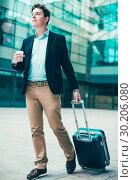 Купить «Portrait of cheerful male standing with bag», фото № 30206080, снято 20 апреля 2017 г. (c) Яков Филимонов / Фотобанк Лори