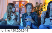 Купить «friends eating pizza and drinking wine at home», видеоролик № 30206544, снято 12 января 2019 г. (c) Syda Productions / Фотобанк Лори