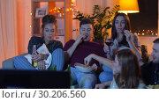 Купить «friends with drinks and snacks watching tv at home», видеоролик № 30206560, снято 12 января 2019 г. (c) Syda Productions / Фотобанк Лори