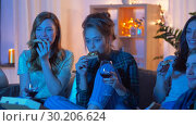 Купить «friends eating pizza and drinking wine at home», видеоролик № 30206624, снято 12 января 2019 г. (c) Syda Productions / Фотобанк Лори