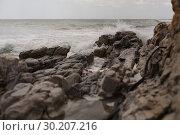 Купить «Sea waves splashing on the rock», фото № 30207216, снято 6 ноября 2018 г. (c) Wavebreak Media / Фотобанк Лори
