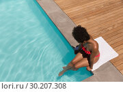Купить «Woman relaxing in a swimming pool on a sunny day», фото № 30207308, снято 7 ноября 2018 г. (c) Wavebreak Media / Фотобанк Лори