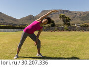 Купить «Woman performing stretching exercise in the backyard of home», фото № 30207336, снято 7 ноября 2018 г. (c) Wavebreak Media / Фотобанк Лори