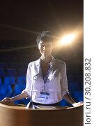 Купить «Businesswoman standing at podium on stage in auditorium», фото № 30208832, снято 15 ноября 2018 г. (c) Wavebreak Media / Фотобанк Лори