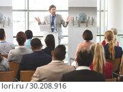 Купить «Male speaker with laptop speaks in a business seminar», фото № 30208916, снято 21 ноября 2018 г. (c) Wavebreak Media / Фотобанк Лори