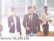 Купить «Business people interacting with each others in office lobby», фото № 30209256, снято 21 ноября 2018 г. (c) Wavebreak Media / Фотобанк Лори