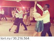 Купить «People learning to dance waltz», фото № 30216564, снято 4 октября 2018 г. (c) Яков Филимонов / Фотобанк Лори