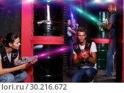 Купить «people with laser guns having fun together in dark labyrinth», фото № 30216672, снято 23 августа 2018 г. (c) Яков Филимонов / Фотобанк Лори