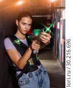 Купить «Portrait of young girl took aim colored laser guns during laser», фото № 30216696, снято 23 августа 2018 г. (c) Яков Филимонов / Фотобанк Лори
