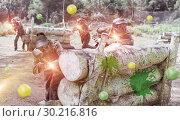 Купить «Paintball players aiming and shooting with guns», фото № 30216816, снято 22 сентября 2018 г. (c) Яков Филимонов / Фотобанк Лори