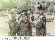 Купить «Paintball team calming upset girl after losing match», фото № 30216820, снято 22 сентября 2018 г. (c) Яков Филимонов / Фотобанк Лори