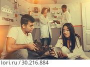 Купить «Young people with military box in lost room-bunker», фото № 30216884, снято 8 октября 2018 г. (c) Яков Филимонов / Фотобанк Лори