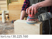 Купить «Worker grinds the wood box», фото № 30225160, снято 5 февраля 2019 г. (c) Jan Jack Russo Media / Фотобанк Лори