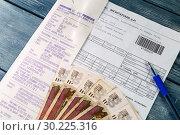 Изображение с квитанцией на оплату (2019 год). Редакционное фото, фотограф Ирина Толокновская / Фотобанк Лори