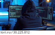 Купить «hacker creating computer virus for cyber attack», видеоролик № 30225812, снято 27 февраля 2019 г. (c) Syda Productions / Фотобанк Лори