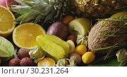 Купить «Panoramic video healthy fresh tropical fruits background with pouring water. Motion, 4K UHD video, 3840, 2160p. Concept of vegetarian diet eating.», видеоролик № 30231264, снято 4 июля 2018 г. (c) Ярослав Данильченко / Фотобанк Лори
