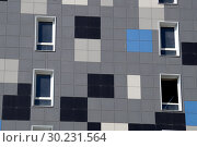 Купить «The new house revetted with a multi-colored granite tile», фото № 30231564, снято 30 сентября 2015 г. (c) Демьянович Вадим / Фотобанк Лори