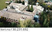 Купить «View from drone of ancient Romanesque monastery Sant Benet de Bagess, Catalonia, Spain», видеоролик № 30231692, снято 24 декабря 2018 г. (c) Яков Филимонов / Фотобанк Лори