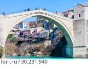 Beautiful view on Mostar city with old bridge and ancient buildings on Neretva river in Bosnia and Herzegovina (2018 год). Редакционное фото, фотограф Николай Коржов / Фотобанк Лори