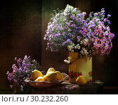 Купить «Bouquet of wild flowers with pears on a wooden table», фото № 30232260, снято 4 октября 2011 г. (c) Марина Володько / Фотобанк Лори