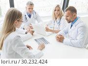 Купить «Team of doctors working in the office», фото № 30232424, снято 25 июня 2017 г. (c) Иван Михайлов / Фотобанк Лори